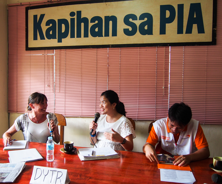 During radio programmes like this in the Philippines, disaster responders explained what assistance the survivors could expect in the aftermath of Typhoon Haiyan. Listeners submitted questions by SMS and via Facebook. Photo credit: Timo Luege
