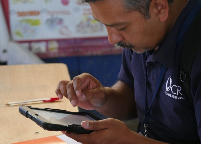 CRS staff using iPad